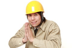 Construction worker folding his hands in prayer Royalty Free Stock Images