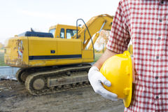 A construction worker or foreman at a construction site. Close-up of a construction worker or foreman at a construction site royalty free stock photography