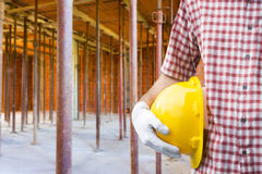 A construction worker or foreman at a construction site. Close-up of a construction worker or foreman at a construction site stock photo
