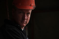 Construction worker foreman portrait. Building, plumbing, carpenter construction worker foreman in hard hat royalty free stock photography