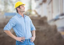 Construction Worker in front of construction site. Digital composite of Construction Worker in front of construction site Royalty Free Stock Image