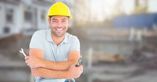 Construction Worker in front of construction site. Digital composite of Construction Worker in front of construction site Royalty Free Stock Photography