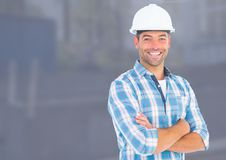 Construction Worker in front of construction site. Digital composite of Construction Worker in front of construction site Royalty Free Stock Photo