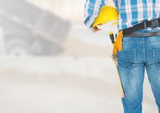 Construction Worker in front of construction site. Digital composite of Construction Worker in front of construction site Stock Photography