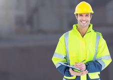 Construction Worker in front of construction site. Digital composite of Construction Worker in front of construction site Royalty Free Stock Photos