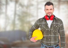 Construction Worker in front of forestry construction site. Digital composite of Construction Worker in front of forestry construction site Royalty Free Stock Image