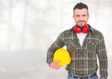 Construction Worker in front of forestry construction site. Digital composite of Construction Worker in front of forestry construction site Royalty Free Stock Photo