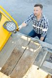 Construction worker in front pile driver machine Stock Images