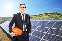 Construction worker in front of solar panels Stock Photo