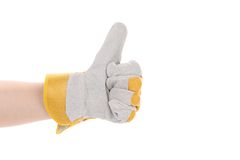Construction worker glove thumbs up. Stock Photo
