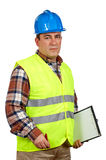 Construction worker with green safety vest. And blank notebook, over a white background Royalty Free Stock Photography