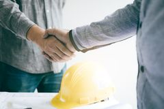 Construction worker greeting a foreman at renovating apartment. Construction worker greeting a foreman at renovating apartment stock photography