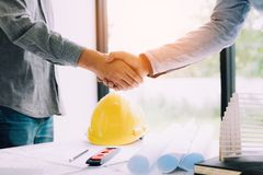 Construction worker greeting a foreman at renovating apartment. stock photos