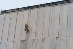 Construction worker and grey cement wall Royalty Free Stock Photo