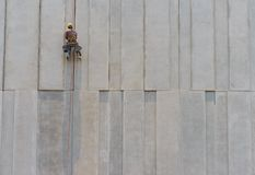 Construction worker and grey cement wall Stock Photo