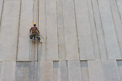 Construction worker and grey cement wall Stock Photography