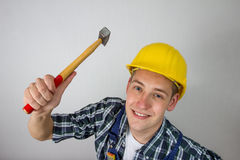 Construction worker with a hammer Royalty Free Stock Images
