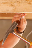 Construction worker with hammer and nail Stock Photos