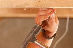 Construction worker with hammer and nail Royalty Free Stock Photos