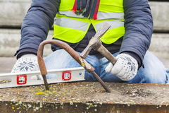 Construction worker with hammer near concrete blocks Stock Photos
