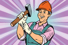 Construction worker with hammer. Construction worker with the repair tool hammer. Comic book cartoon pop art retro colored drawing vintage illustration Stock Image
