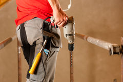 Construction worker with hand drill Royalty Free Stock Image