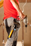 Construction worker with hand drill Stock Image