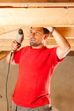 Construction worker with hand drill Stock Photos