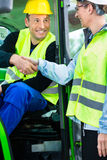Construction worker hand shake with engineer on construction sit Royalty Free Stock Image