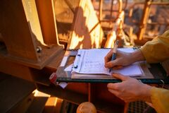 Free Construction Worker Hand Signing Safety Risk Assessment JHA Paper Permit To Work Royalty Free Stock Photography - 191482247
