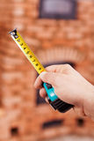 Construction worker hand with tape-measure Stock Image