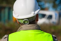 Construction Worker In Hard Hat On Building Site Stock Photo