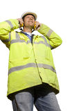 Construction worker in hard-hat, headphones and reflector jacket Stock Images