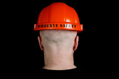 Construction worker in hard hat with an inscription observe safe Royalty Free Stock Photos