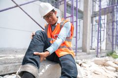 Construction worker has an accident while working Stock Image