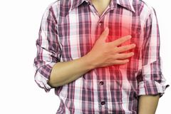 Construction worker has suffering from chest pain, severe heart ache, attack on white background, concept as healtcare. Disease and save stock photos