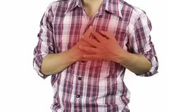 Construction worker has suffering from chest pain, severe heart ache, attack on white background, concept as healtcare,. Disease and save stock photo