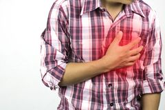 Construction worker has suffering from chest pain, severe heart ache, attack on white background, concept as healtcare, royalty free stock photography