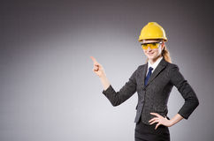 Construction worker in helmet against gray Royalty Free Stock Photo