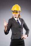 Construction worker in helmet against gray Stock Photo