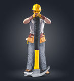 Construction worker in helmet with tool and hammer Royalty Free Stock Photos