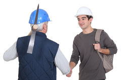 Construction worker with his trainee. Stock Photography