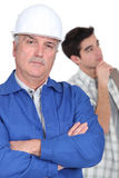 Construction worker and his trainee. Stock Photography