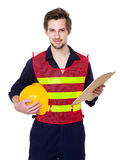 Construction worker hold with clipboard and hardhat Stock Photo