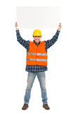 Construction worker holding baner abover his head. Stock Photography