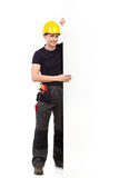Construction worker holding a big white banner Royalty Free Stock Photo