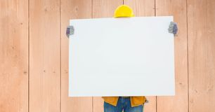 Construction worker holding blank bill board Stock Image