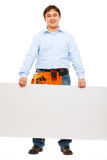 Construction worker holding blank billboard. Smiling construction worker holding blank billboard stock photo