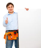 Construction worker holding blank billboard Stock Image