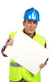 Construction worker holding the blank poster. Construction worker with green safety vest holding the blank poster Stock Photo